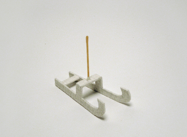 "sled , 2011. Cut-and-pasted Japanese handmade mending paper, archival corrugated cardboard, craft stick. 5"" x 5.75"" x 2.5"""
