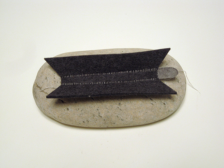 "island duskywings , 2012. Rock, industrial wool felt hand stitched with silk thread. 3.25"" x 8"" x 4.5"""