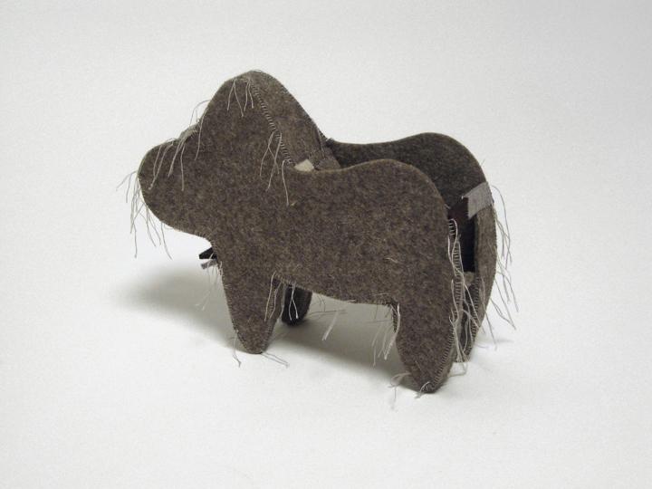 """Crib , 2011. Industrial wool felt hand stitched with silk thread. 8.5"""" x 11"""" x 6"""""""