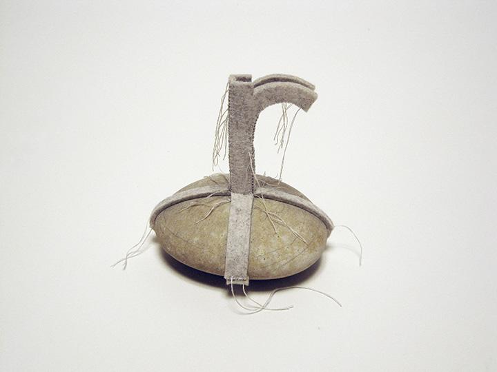 """island r , 2012. Pencil on rock, industrial wool felt hand sewn with silk thread. 5"""" x 5"""" x 4.5"""""""