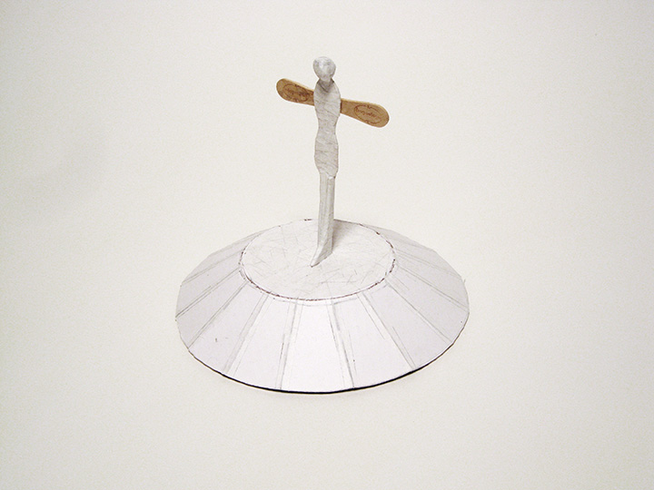 "monument (North Pole) , 2013. Archival corrugated cardboard, cut-and-pasted handmade Japanese mending paper, hazelnut, wooden ice cream spoon. 8.5"" x 9.5"" x 9.5"""