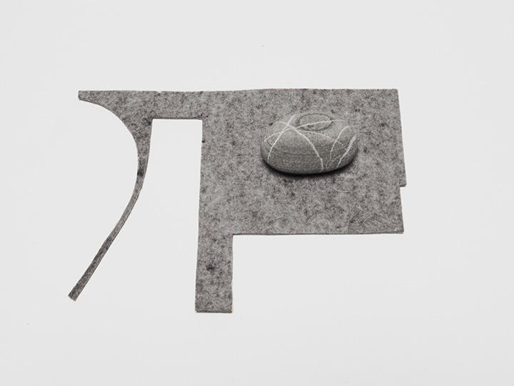 "island orbit , 2012. Rock, industrial wool felt. 1.5"" x 8.5"" x 6"""