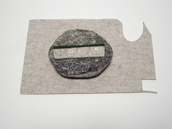 "island fierce garden , 2012. Rock, pencil on industrial wool felt hand sewn with silk thread, pearl buttons. 2"" x 14"" x 9"""