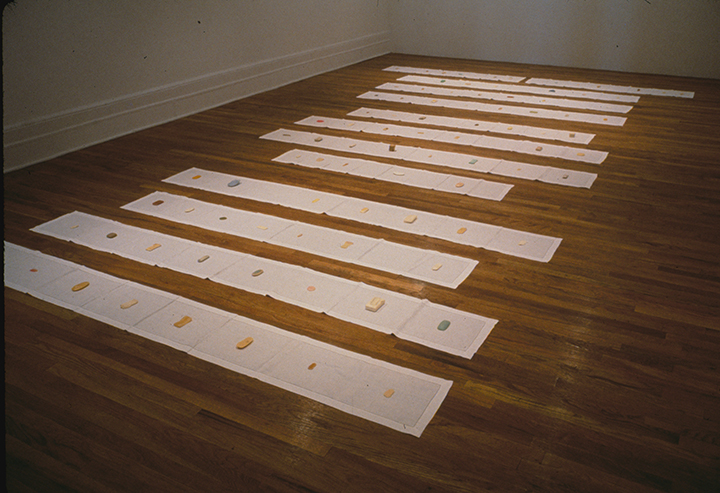 Homage to Francis Ponge,  1989-1991. Soaps stolen from public bathrooms, linen runners, text. Dimensions variable