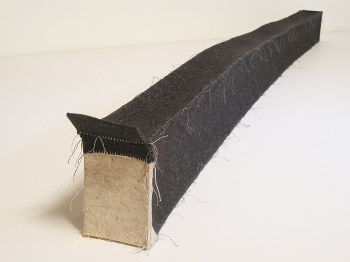 "Long Box,  2017. Industrial wool felt hand stitched with silk thread. 6"" x 56.25"" x 4"""