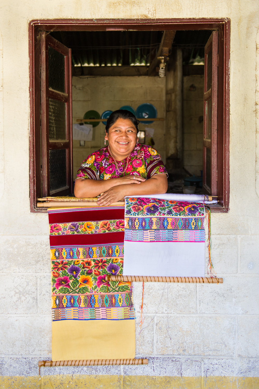 Picture of a woman and traditional embroidery in Guatemala by Dawn Deeks nonprofit photography