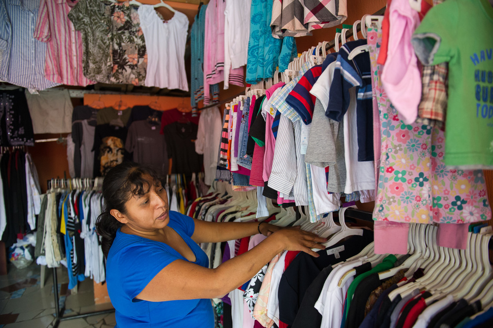Picture of a Guatemalan clothing shop owner by Dawn Deeks nonprofit photography
