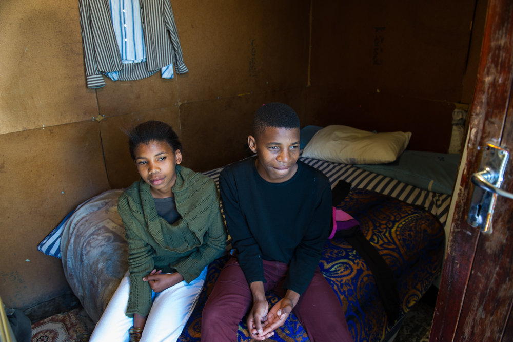 Nosi and her brother Zweli share this shack with an older sister. Their eldest brother moved them here after their parents died. Even though they are minors, he doesn't want to take responsibility for them.