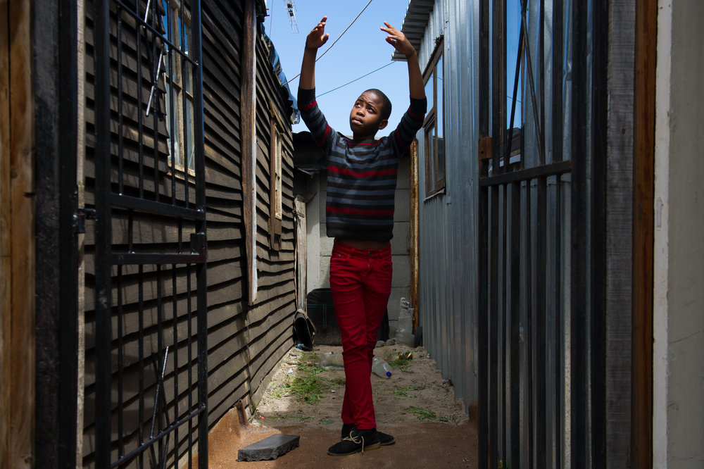 Sindesile practices outside of the home he shares with his mother and siblings. He dreams of being a doctor one day and uses dance as a way to learn about the human body.