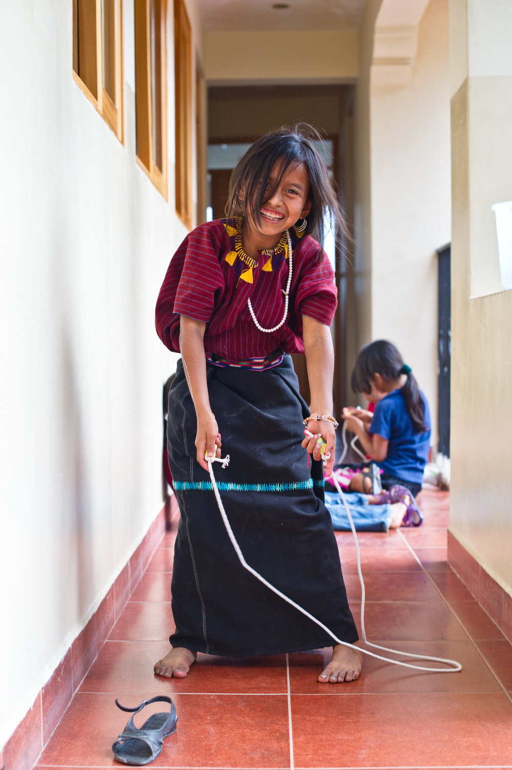 The craft projects are built around materials that are easily found in the pueblo. Items like rope, empty snack bags and discarded bottle caps become jump ropes and art materials.