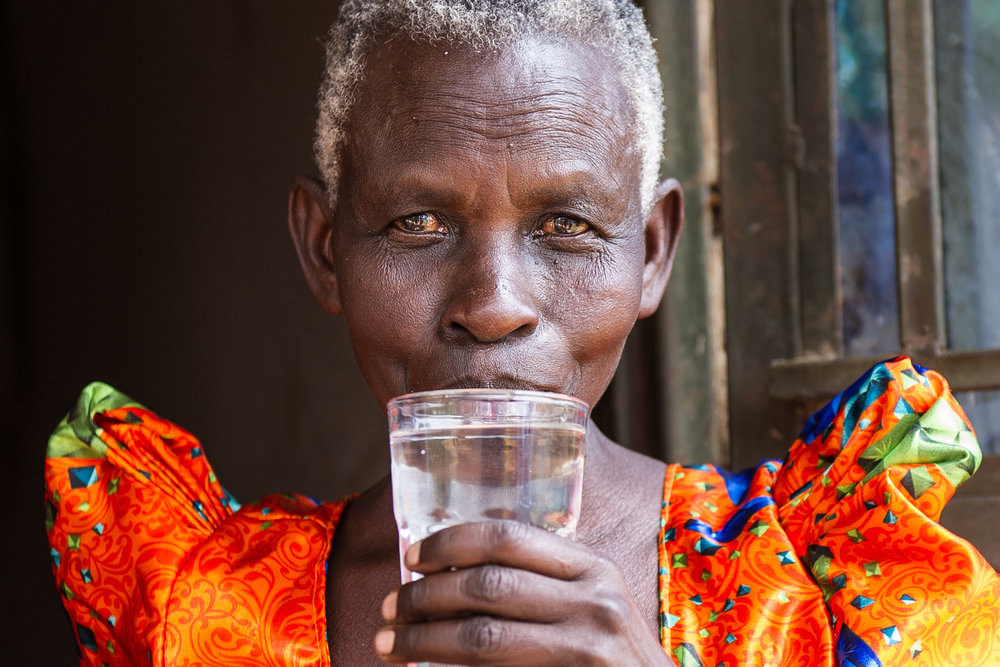 Now that Jane has a water purification filter made from clay, she has clean water for her family to drink.