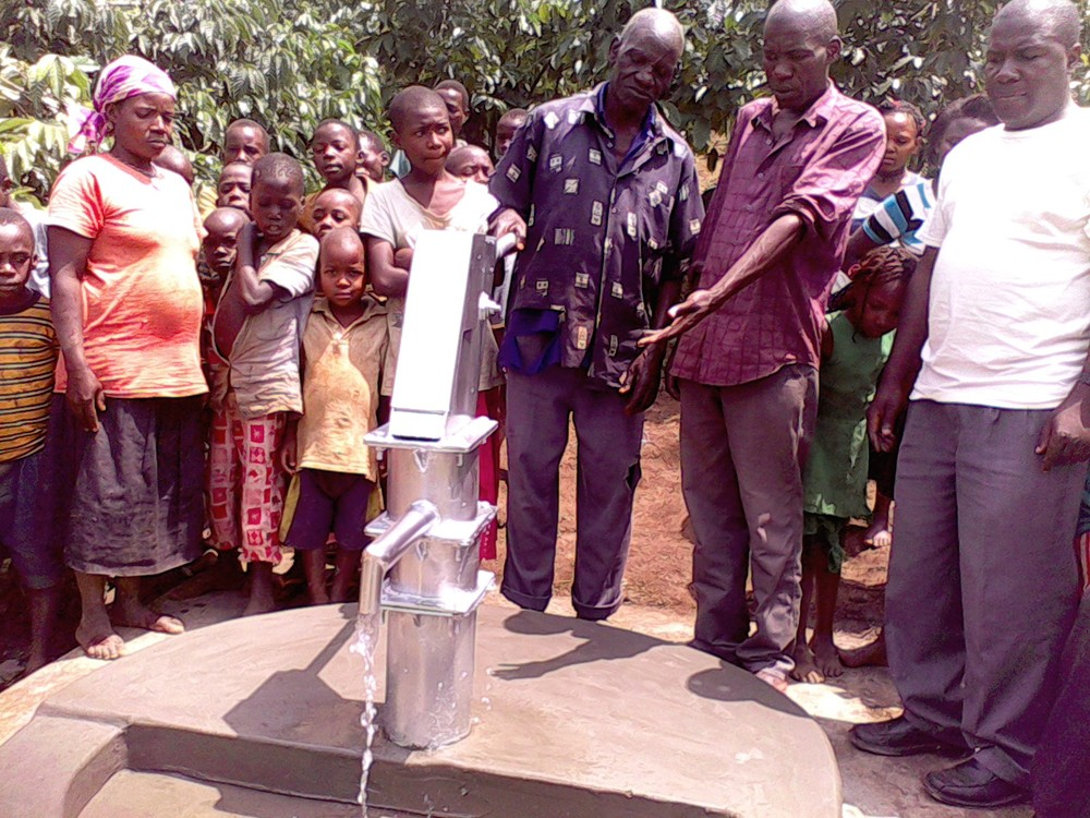 The chairman of the community is testing the water pump.