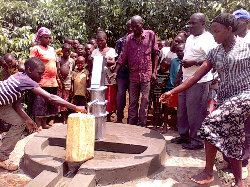 A child fills his family's jerry can with clean water!
