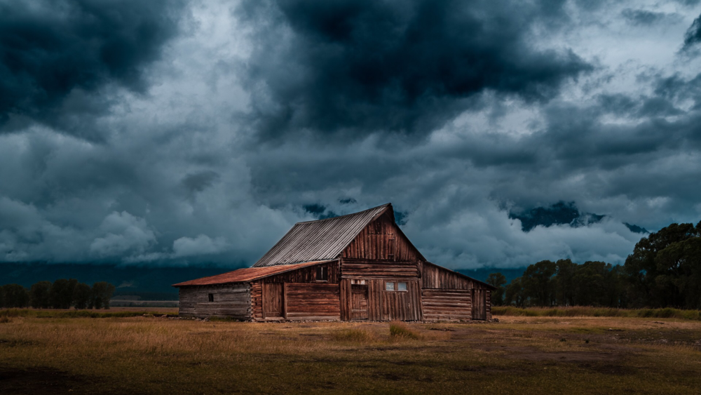 Barn and clouds.png
