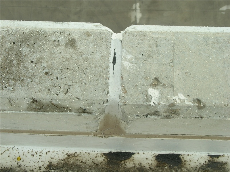 Sealant failure at the top of a tilt-up wall joint.