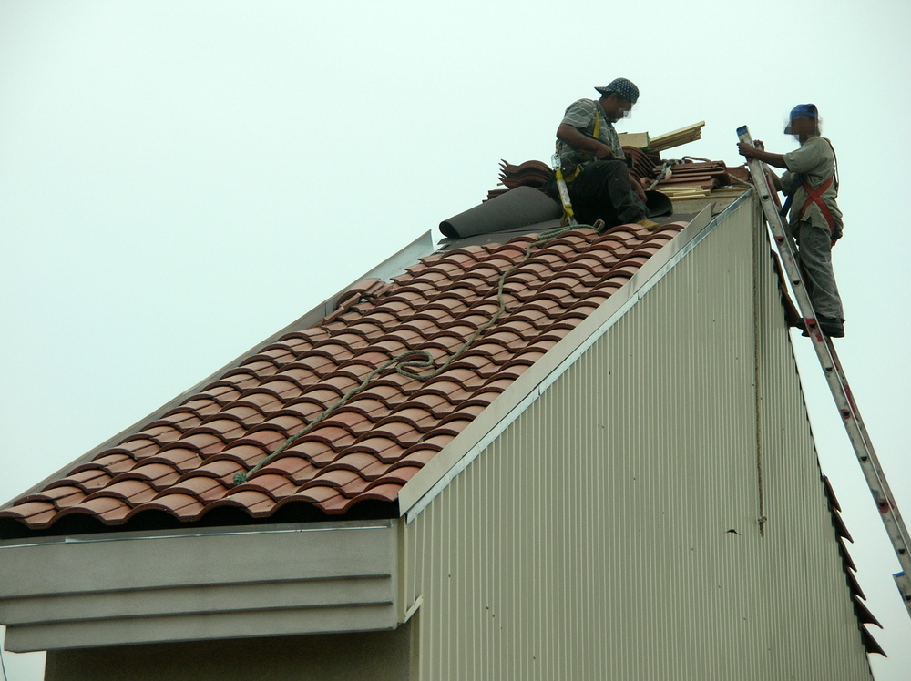 Installing a clay tile roof at a shopping center in Texas.