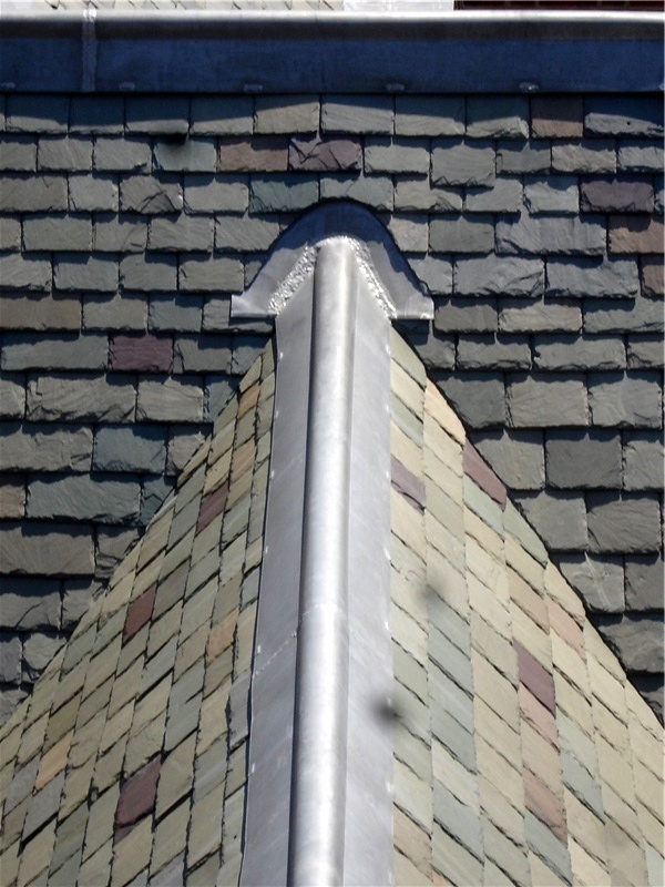 Dormer detail on a slate roof.