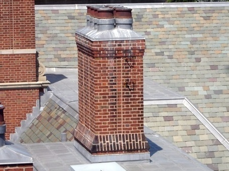 A chimney on a flat roof area.