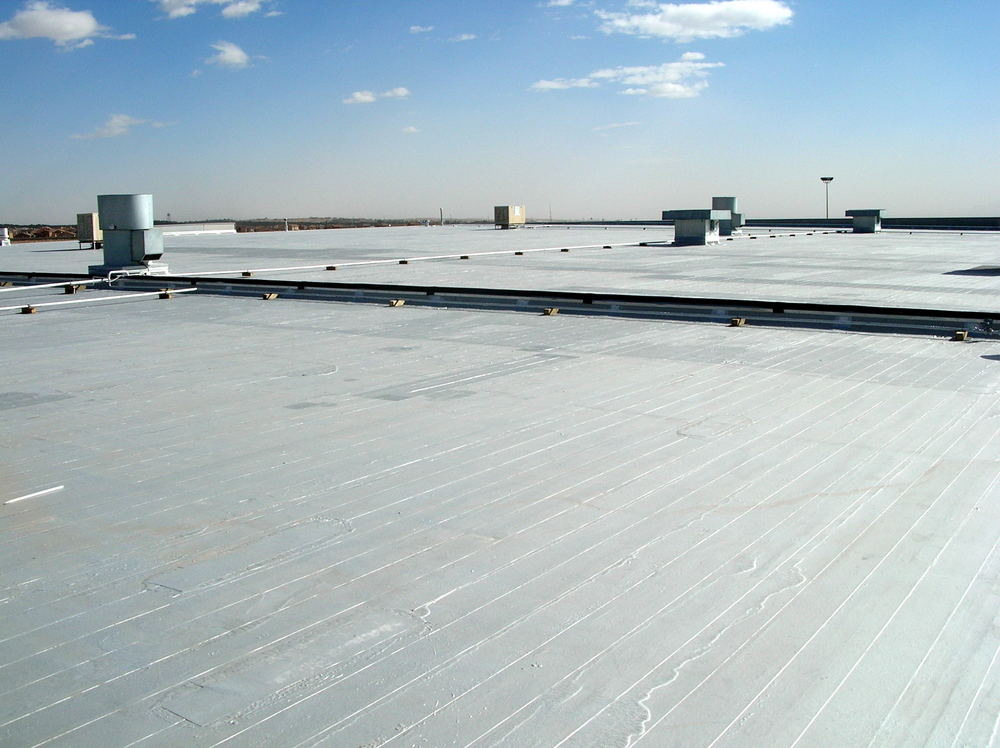 Low-slope roof: an emulsion-surfaced asphalt built-up roof with aluminum roof coating.