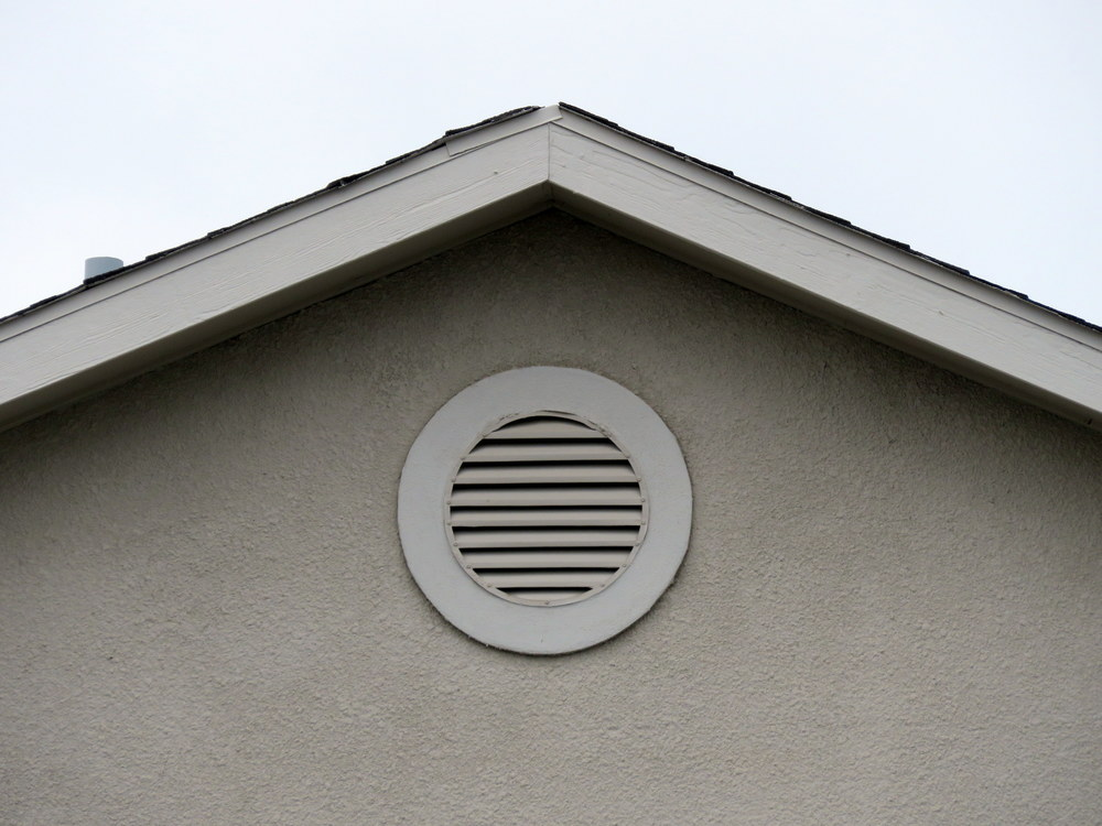 A round gable vent.