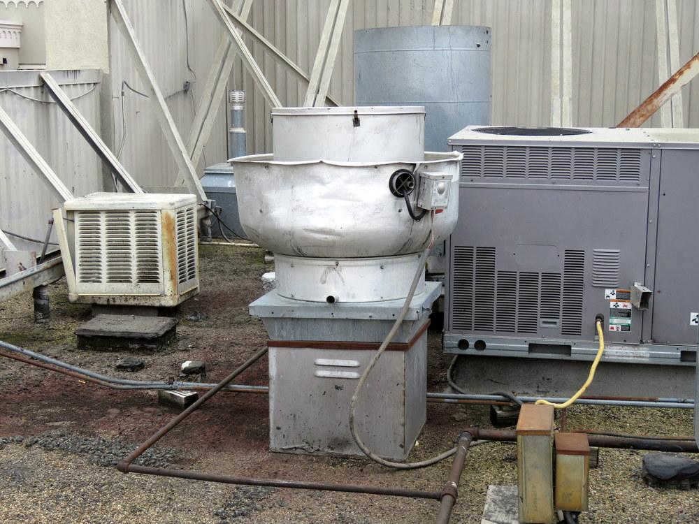 Exhaust fan unit over a restaurant kitchen.