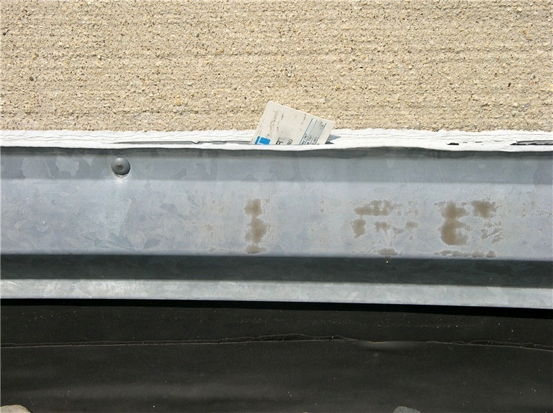 Sealant deteriorates. It's a fact. A common roof maintenance item is the replacement of old sealant at the top of the flashing at parapet walls and rooftop structures.