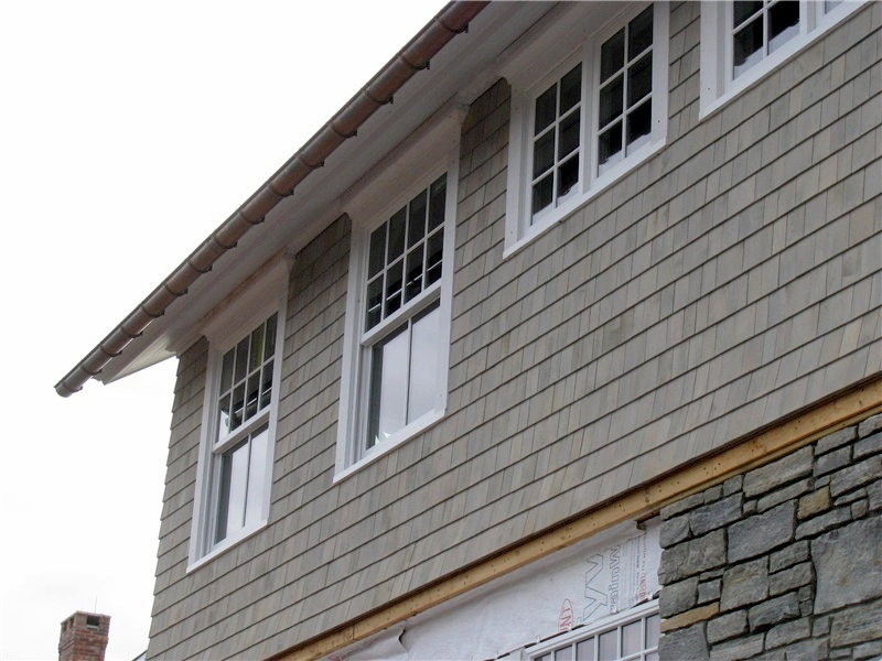 Wood shingle siding.
