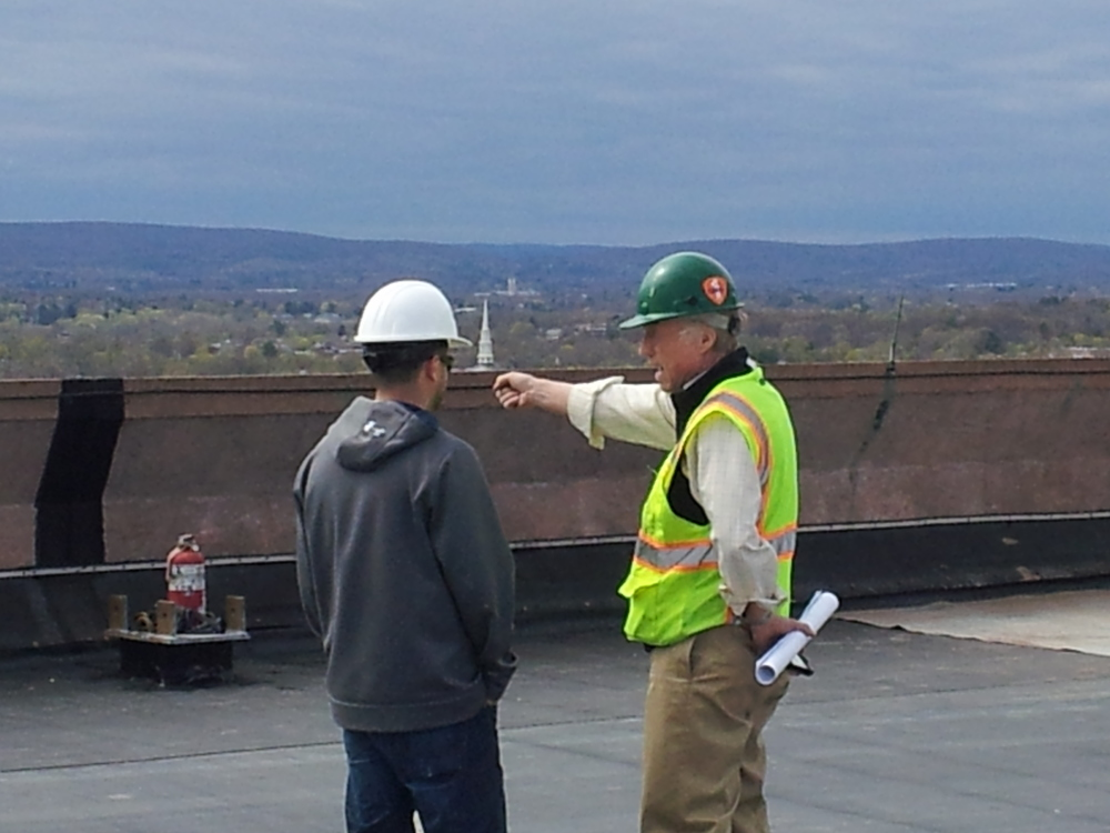 A roof consultant making sure the contractor follows the spec.