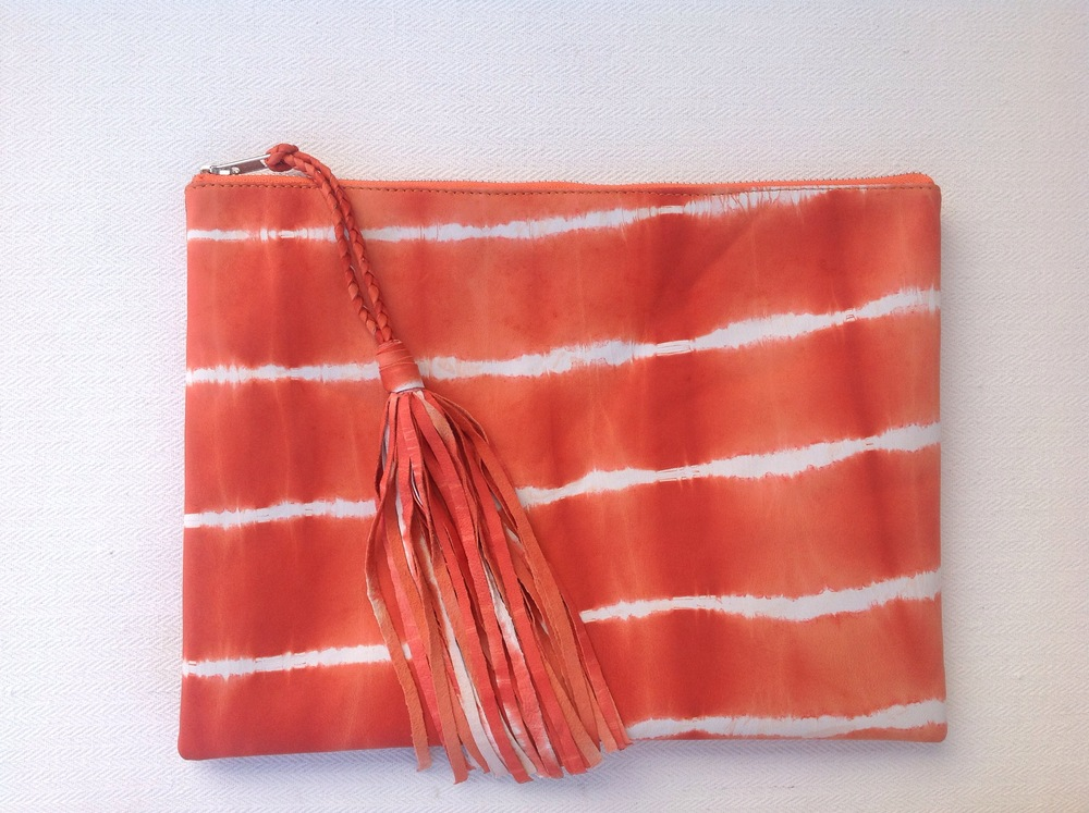 Update your summer wardrobe with one ( or more) of these amazing Istana Leather Tye Dye clutches in pink, orange and blue - $70
