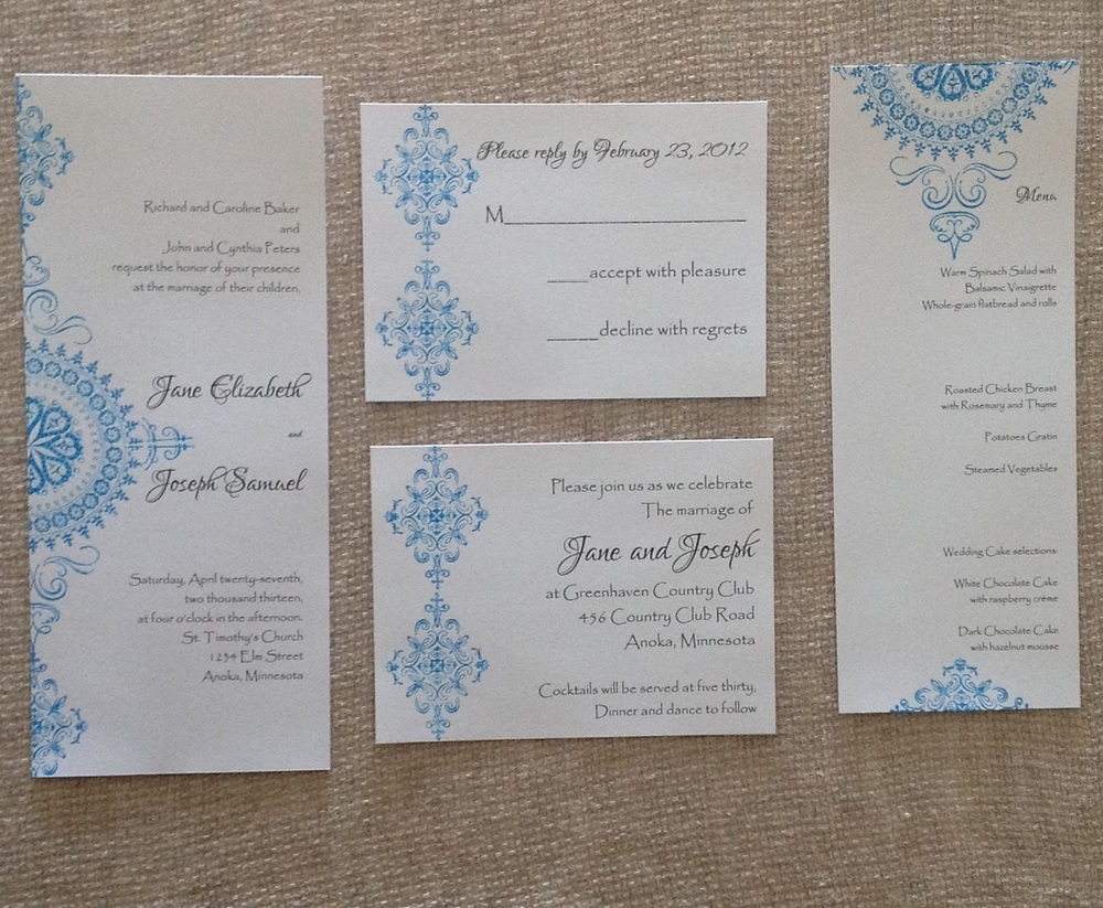 Stamped turquoise medallion invitation suite   $$$