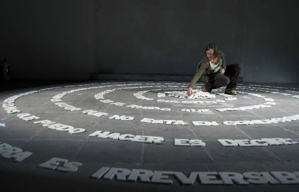 DIANNE PEARCE  Stammer and Rustle  (title after Roland Barthes), 2006-2007 Spiral of hand-made porcelain letters set on floor, the public can walk through it. Approximately 20 ft diameter.