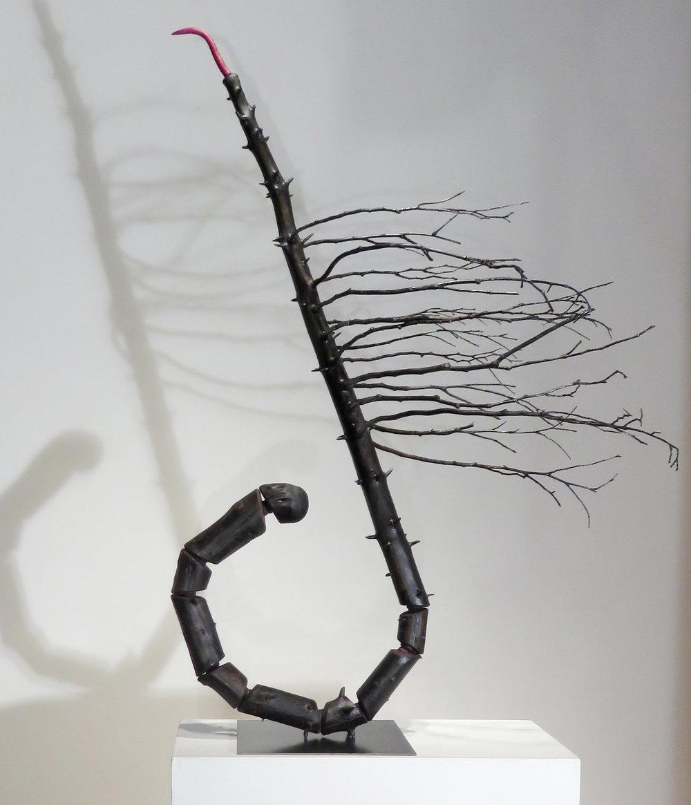 "Expectations II  Spruce tree, cedar branches,foam, acrylic paint, steel base 50"" x 38""x 28"" 2016"