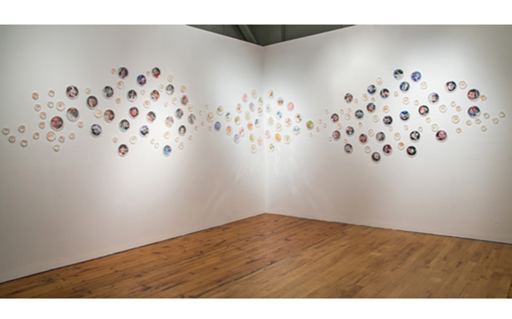 "I Caught it at The Movies,  2013 320"" x 48"" x 2"" Petri dishes, digital images, mylar, gouache, agar, Halobacterium sp. NRC-1"