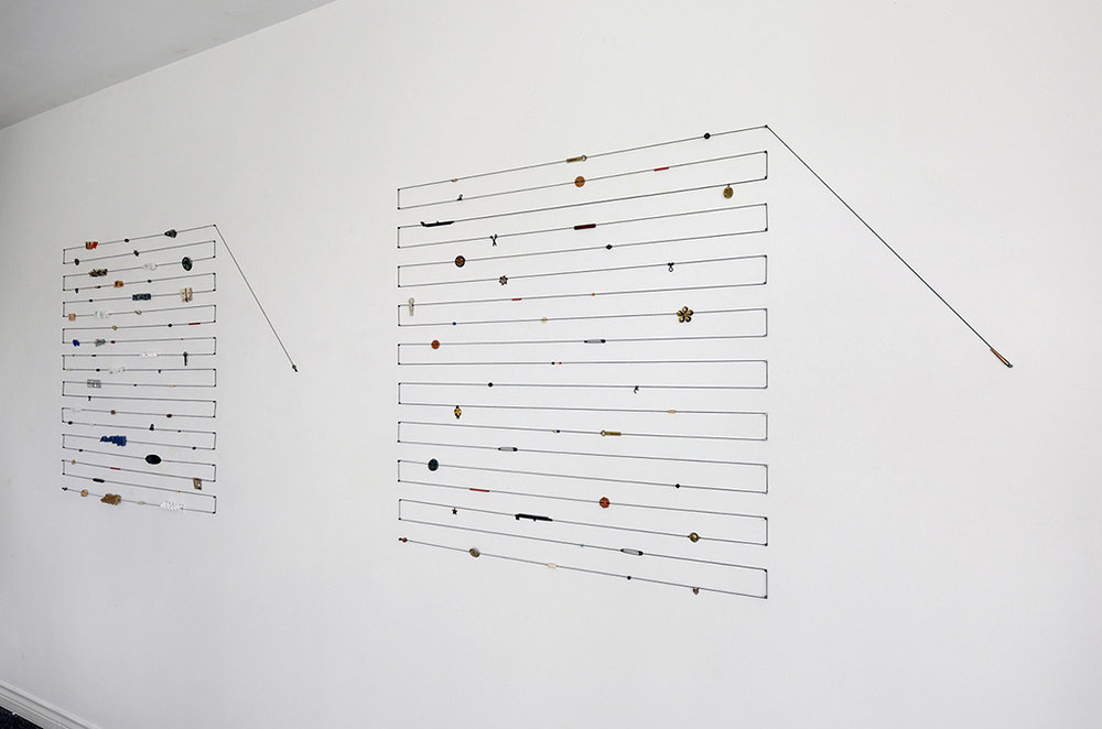 "Marking Time 2, 2016 Mixed Media Elastic cord and objects 115"" w x 38"" h x ½"" d"