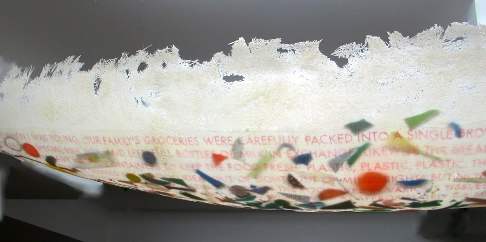 Turgid Tides  (Detail), 2016 Fibreglass, plastic bits, writing on clear food wrap 2.8m x 38 x 38 cm