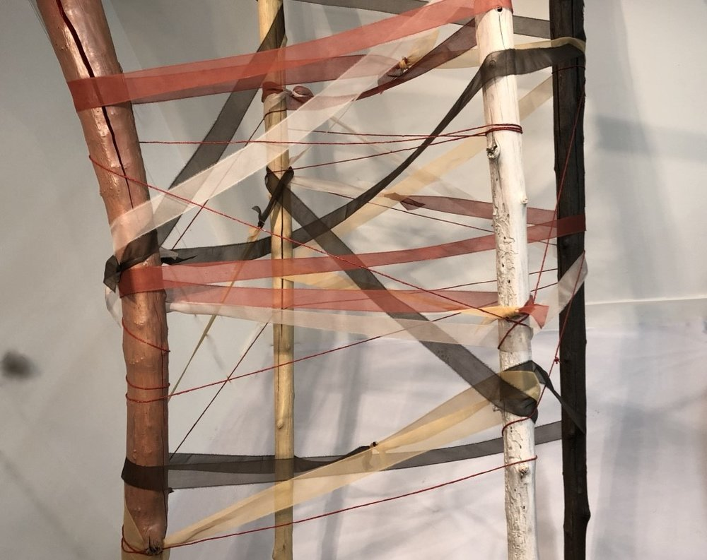 "Sally Thurlow    The Ties That Bind,  2018 Driftwood, acrylic paint, silk, wool, steel 33"" x 10'  Blessed or not are the ties that bind."
