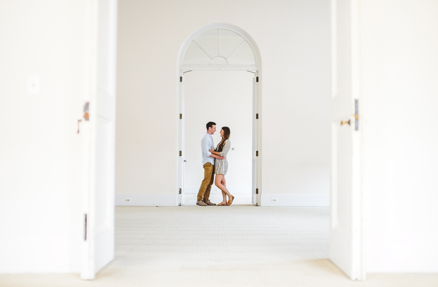 001 couple embracing in doorway