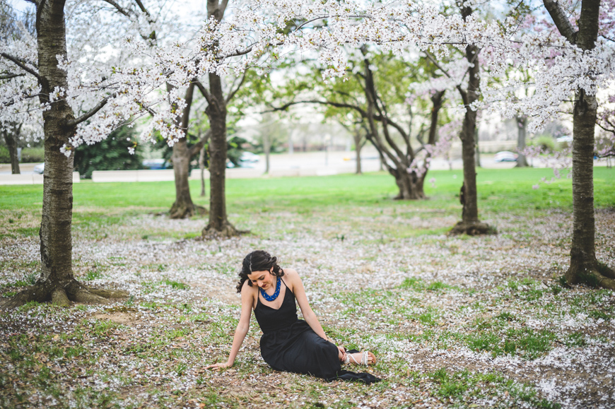 001 girl sitting in cherry blossoms washington DC
