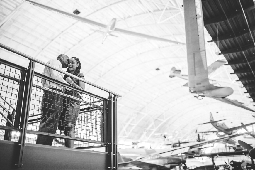 003 black and white of couple at air and space museum engagement session