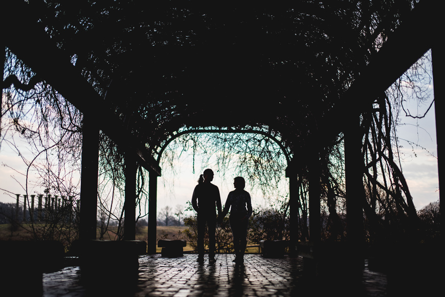 003 silhouette of couple under ivy awning