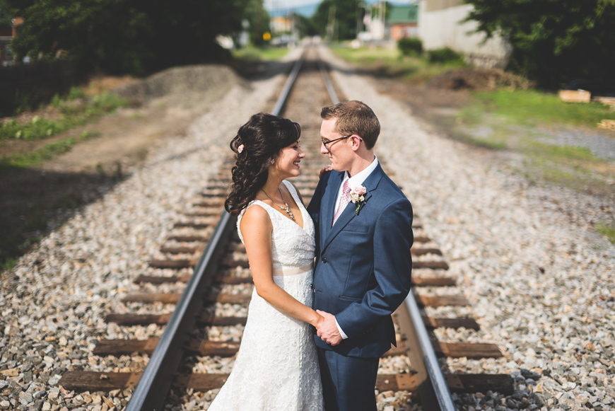 003 wedding couple on railroad tracks
