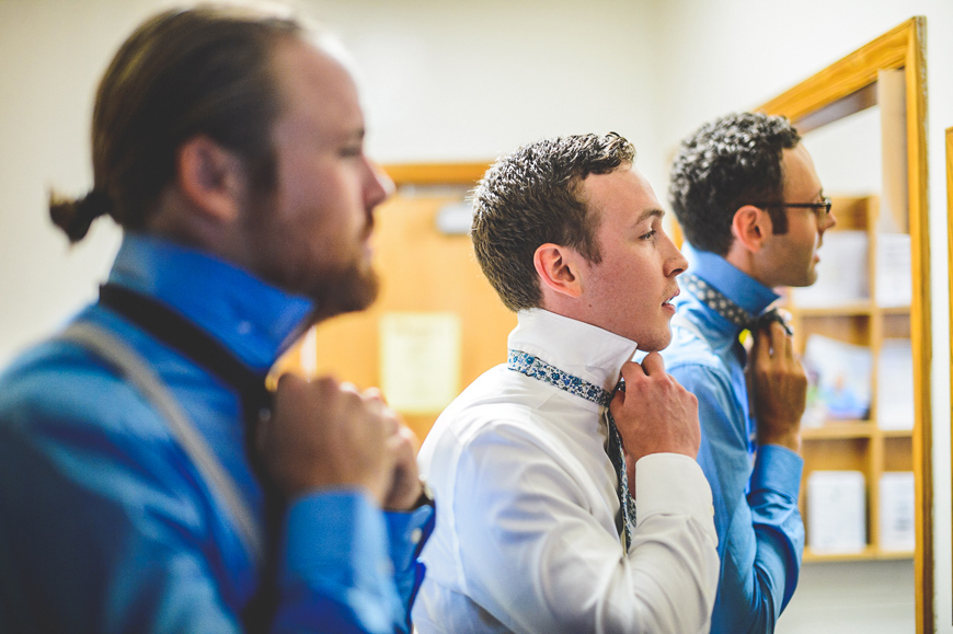 004 groom and groomsmen tying bowties