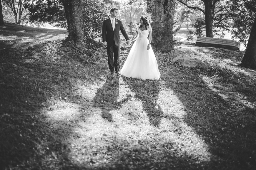 006 black and white portrait of bride and groom in grove of trees
