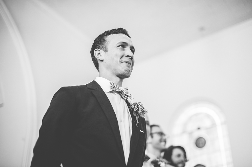 006 groom reacts to bride walking down the aisle