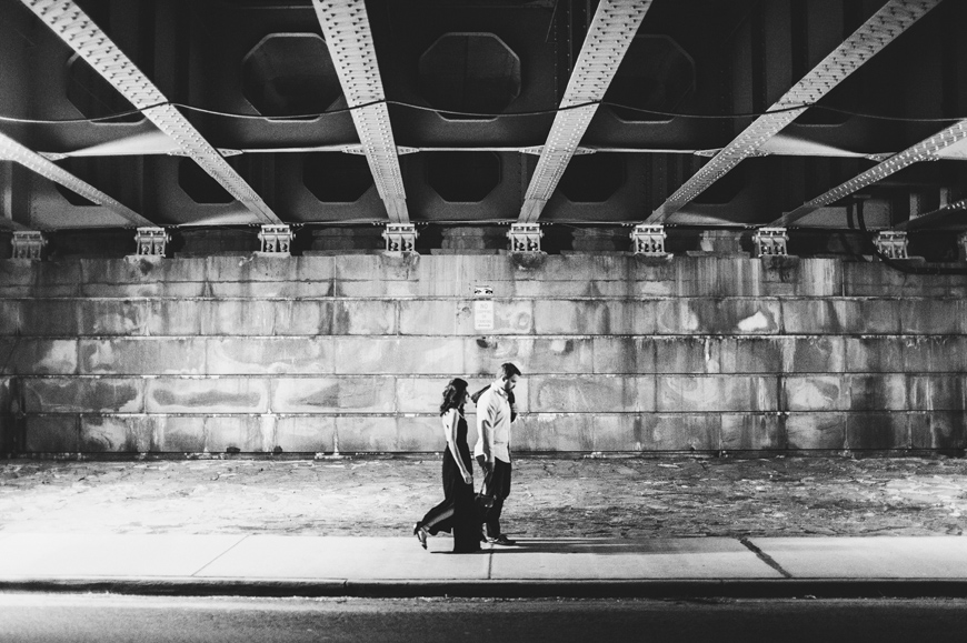 013 black and white couple walking under bridge