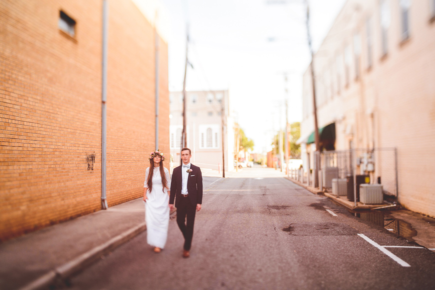 013 freelens as bride and groom walk through alley