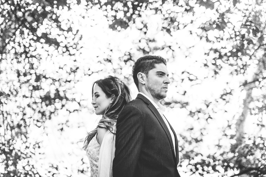 007 creative black and white portrait of couple in trees.jpg