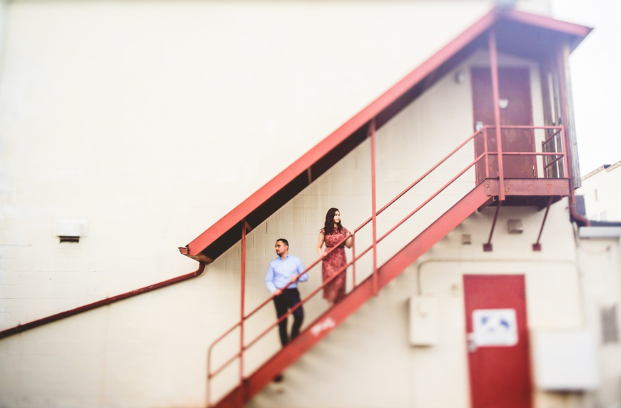 003 portrait of couple on red metal staircase.jpg