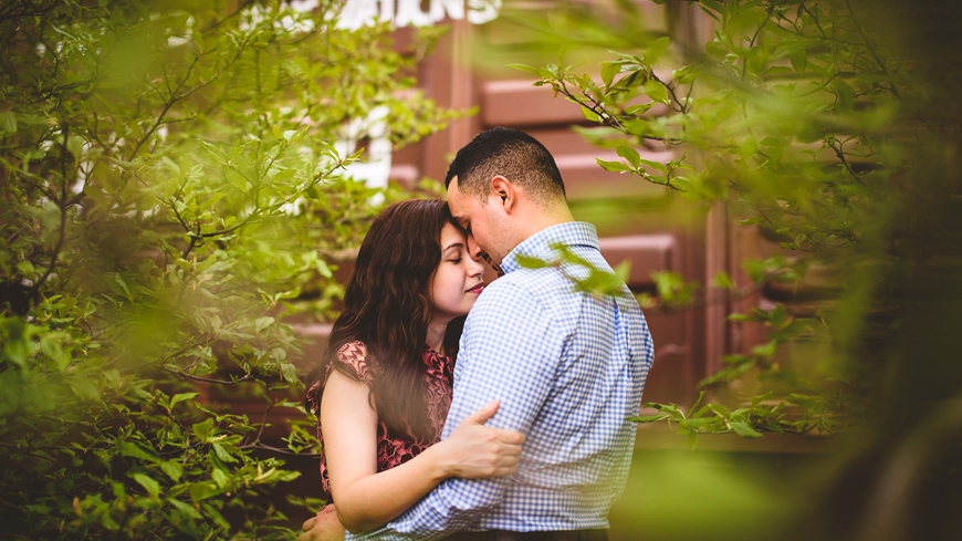 008 couple sharing moment together in green trees.jpg