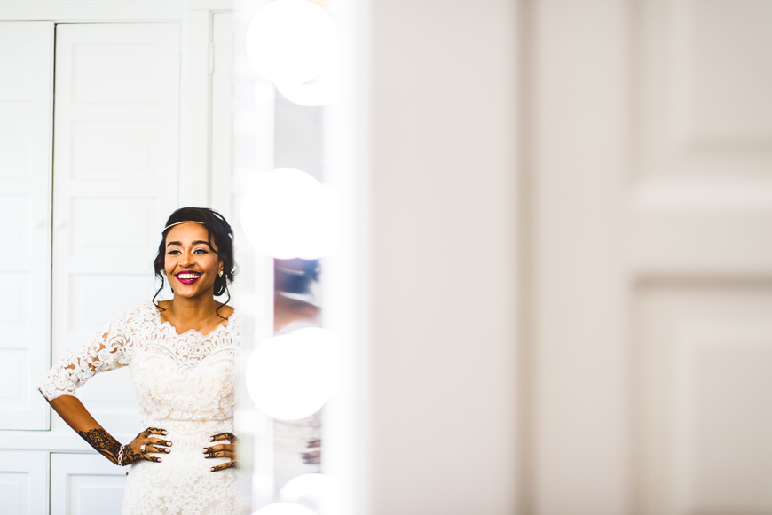 004 beautiful bride laughing in mirror.jpg